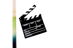 Movie clapper board with filmstrip on white